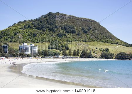 The beach in Mount Maunganui resort town with the same name mountain in a background (Tauranga New Zealand).