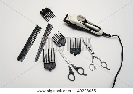 Barber Hair Cutting Set with Trimmer, scissors, combs and attachments. poster
