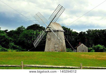 Brewster Massachusetts - July 10 2013: 18th century Higgins Farm smock windmill and c.1795 Harris-Black House