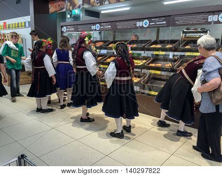 KAZANLAK, BULGARIA - JUNE 05, 2016: Women in national dress are buying bread. After the Rose Festival
