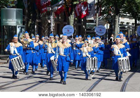 ZURICH - AUGUST 1: Zurich city orchestra in traditional costumes openning the Swiss National Day parade on August 1, 2012 in Zurich, Switzerland.