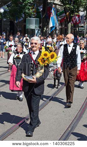 ZURICH - AUGUST 1: Swiss National Day parade on August 1, 2012 in Zurich, Switzerland. Representative of canton Appenzeller in a historical costume.