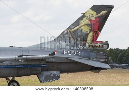 VOLKEL, NETHERLANDS - JUN 15: Fighter jet with painting of a woman on the back during the Royal Netherlands Air Force Day