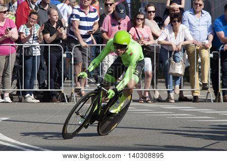 Apeldoorn, Holland, May 6, 2016:Rigoberto Uran from team cannondale drive fast curve in the prologue of the Giro the italia with spectators