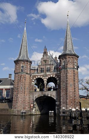 Sneek, Holland - april 6,2013: The famous watergate in sneek and people in the background.