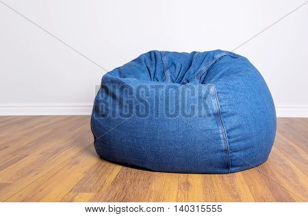 Denim Beanbag Resting on Laminated Flooring in a Room