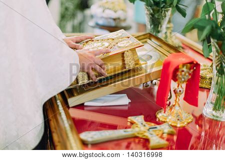 Pastor reads bible during wedding ceremony in Orthodox Church.