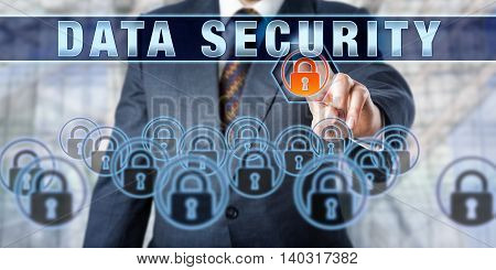 Male corporate executive is pushing DATA SECURITY on a touch screen interface. Business and security industry metaphor. Information technology concept for data management and protection.