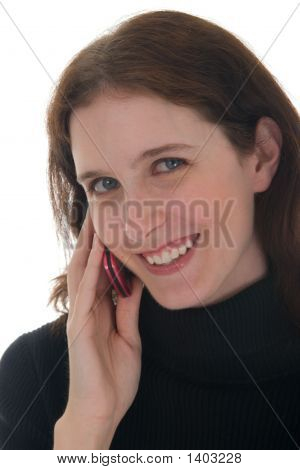 Close-Up Of Smiling Woman On Cell Phone