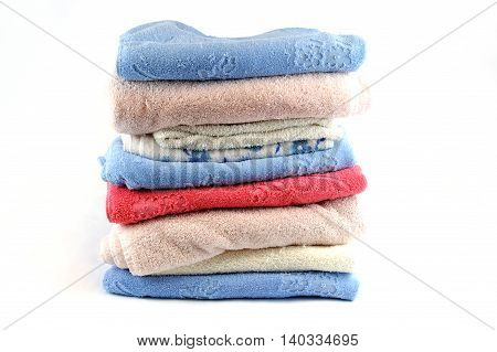 stacking old bath towels isolated on white background