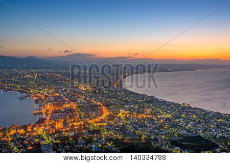Hakodate, Hokkaido, Japan city skyline from Mt. Hakodate at dawn.