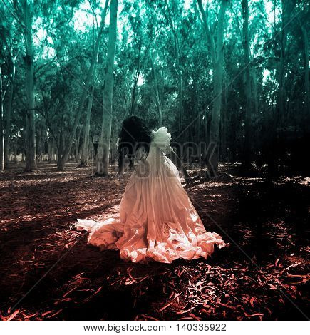 Mysterious Woman in White Dress in the Forest,Scary Woman in the Wood,Horror Background For Halloween Concept and Book Cover Ideas