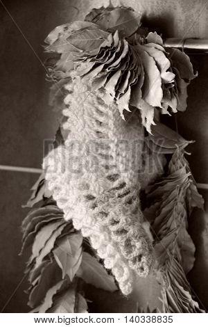 Dry laurel wreath close up. Kitchen interior. Monochrome toned