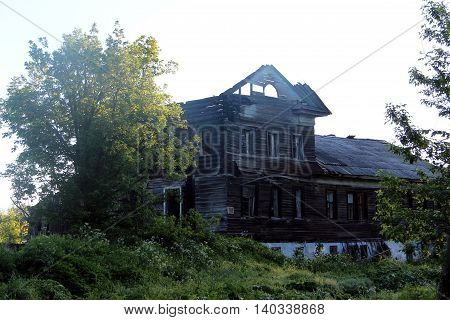 Old destroyed house. Burnt exterior of building