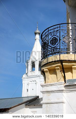 Old building with an iron balcony. Courtyard of Spaso-Prilutsky Monastery in the Vologda city, Russia. Summer sunny day