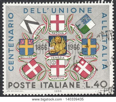 MOSCOW RUSSIA - CIRCA APRIL 2016: a post stamp printed in ITALY shows arms of Venice and other cities devoted to the 100th Anniversary of Venezia's Union with Italy