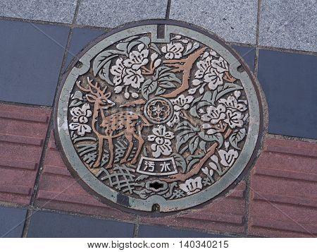 NARA, JAPAN - JUNE 06, 2016: The deer was engraved on manhole cover of Nara City in Nara, Japan.