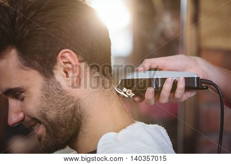 Man getting his hair trimmed at the hair salon