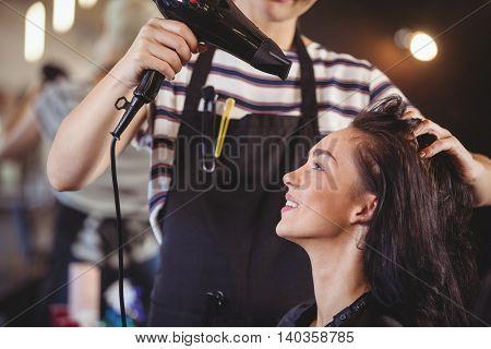 Woman getting her hair dried at the hair salon