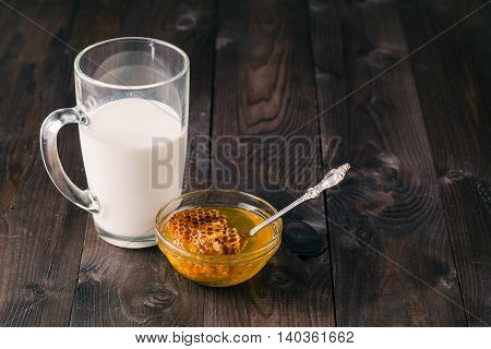 milk and honey on dark wooden table
