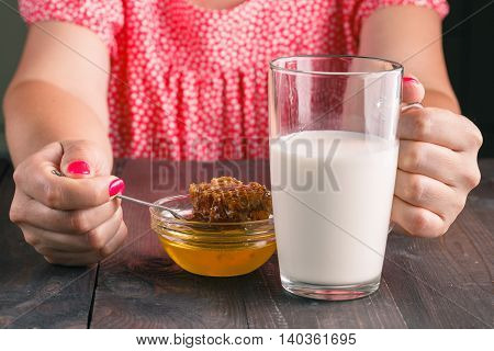 Oung Woman Having Healthy Breakfast In Kitchen