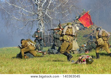MOSCOW REGION - OCTOBER 13, 2013: Reenactors dressed as WW II soldiers at Moscow Battle historical reenactment.