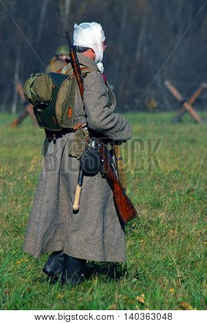 MOSCOW REGION - OCTOBER 13, 2013: Reenactor dressed as WW II soldier. The battle he is reenacting was the Moscow Battle held in 1941.