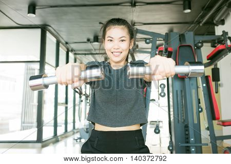 Woman Lifting Dumbell For Sport Body Strong And Beautiful