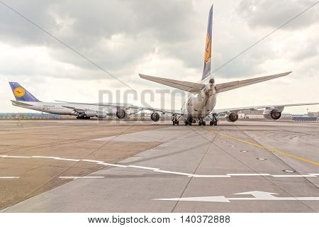 FRANKFURT GERMANY - JULY 24 2016: Lufthansa Boeing 747 airplanes at the taxiway of Frankfurt International Airport