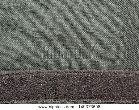 dark green cloth khaki on which is sewn a Velcro , close up