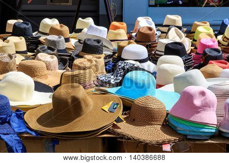 Variety of sun hats displayed in a street market