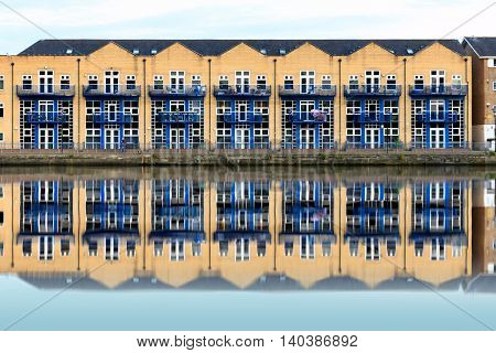 Terraced houses along Millwall Outer Dock in London UK