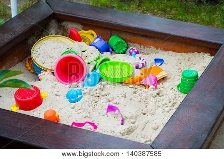 Nursery sandbox on the playground with sand bucket rake shovel sieve and other equipment for sand work