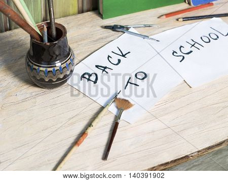 Various educational objects laid on the desk selective focus angled shot concept of back to school