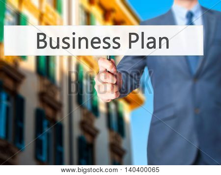 Business Plan - Business Man Showing Sign