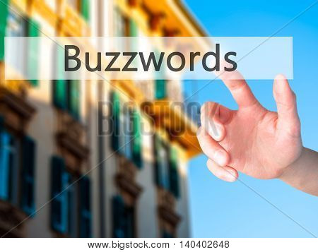 Buzzwords - Hand Pressing A Button On Blurred Background Concept On Visual Screen.