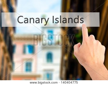 Canary Islands - Hand Pressing A Button On Blurred Background Concept On Visual Screen.