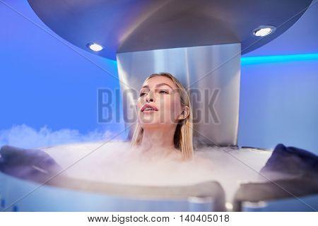 Young Woman In A Cryo Sauna Chamber