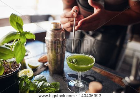 Bartender Preparing Fresh Basil Smash Cocktail