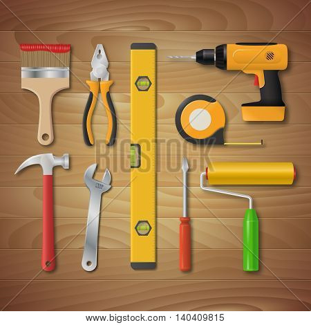 Vector realistic hand tool set. Electric drill, hammer, pliers, paint roller, screwdriver, spanner, paintbrush, meter, spirit level. Illustration of tools for home renovation and construction.