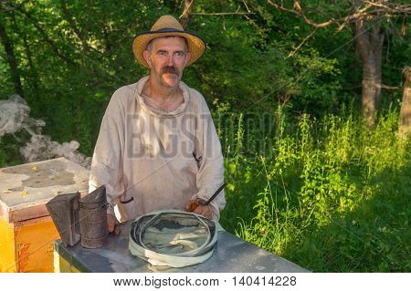 Portrait of Ukrainian bee-keeper on his apiary