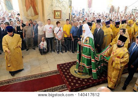 Orel Russia - July 28 2016: Russia baptism anniversary Divine Lutirgy. Patriarch Kirill in green ceremonial mantle and clergy in golden robes in orthodox church