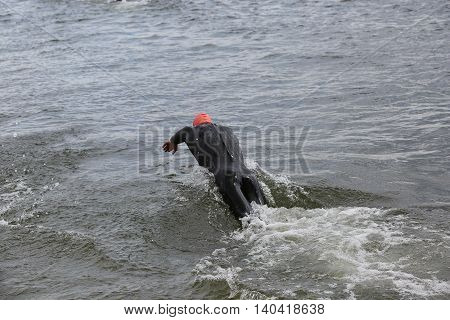 Diving Athlete In Triathlon Competition