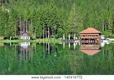 DOBBIACO ITALY - JULY 12: View of Dobbiaco lake in Veneto Italy on July 12 2014. Dobbiaco is a famous lake in Dolomites province Veneto Italy.