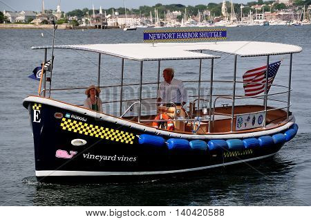 Newport Rhode IslanD - July 17 2015: A Vineyard Vines Newport Harbor Shuttle Taxi on Narragansett Bay arriving at Fort Adams State Park
