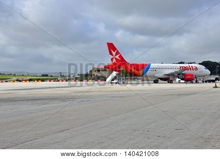 VALLETTA MALTA - FEBRUARY 17: Air Malta airbus going to depart from Luqa Malta airport on February 17 2014. Malta International Airport is the only airport in Malta and it serves the whole Maltese Archipelago.
