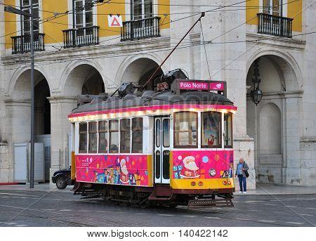 LISBON PORTUGAL - DECEMBER 5: Pink christmas tram goes around Lisbon city center on December 5 2013. Special Xmas events hold in Lisbon from 5 till 31 december 2013.