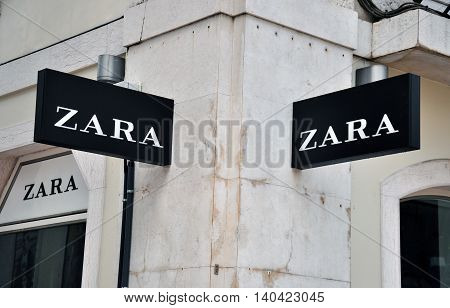 Lisbon Portugal - December 25 2013: Zara store sign on the grey building on Agusta street in Baixa district of Lisbon on December 25 2013. Lisbon is the largest city and capital of Portugal with a population of 547 000 citizens.