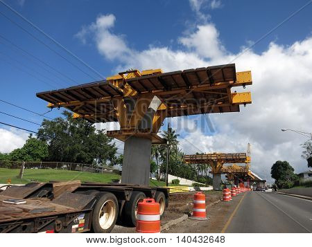 HONOLULU - NOVEMBER 29: HART Light Rail concrete guideway under construction in road center in Pearlrigde on Oahu Hawaii on November 29 2015. HART is building a 8 billlion dollar railway linking Oahu communities.