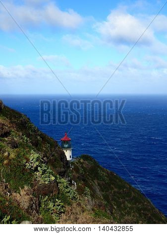 Historic Makap'uu Point Light (Makapu'u Lighthouse) on cliffside of the island of Oahu with view of Pacific Ocean. It has the largest lens of any lighthouse in the United States. 2015.